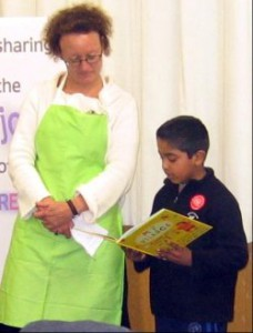Publisher Julia Marshall at the launch of My Village with one of the children who read a poem in his own language.