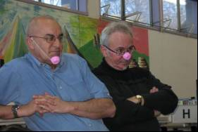 Photo: Christchurch School Library Service Librarians, John Kenny and John Bartlett listening to Piggity Wiggity with their piglet masks.