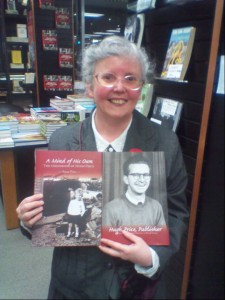 Image Susan Price holding biography of her father Hugh Price