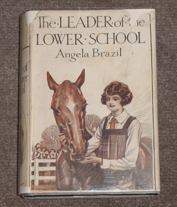 Dustjacket of Leader of the Lower School by Angela Brazil, after repair